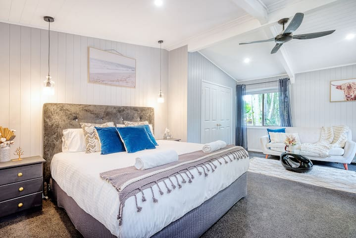 The Master bedroom is a retreat on its own, including a King bed + ceiling fan, luxury ensuite with a shower over the tub, and built-in wardrobe for a home away from home.