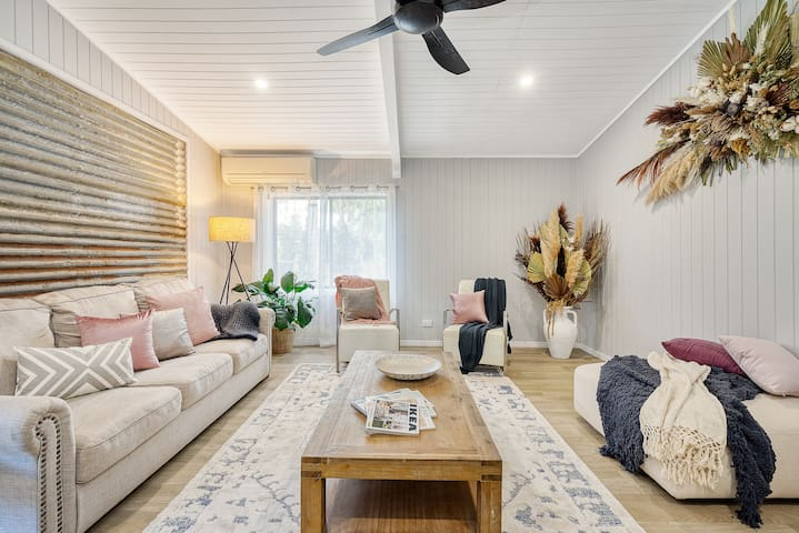 Sprawl out in the spacious living area with plenty of seating, air-con, and Smart TV with Netflix access