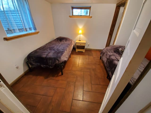 Two single beds downstairs