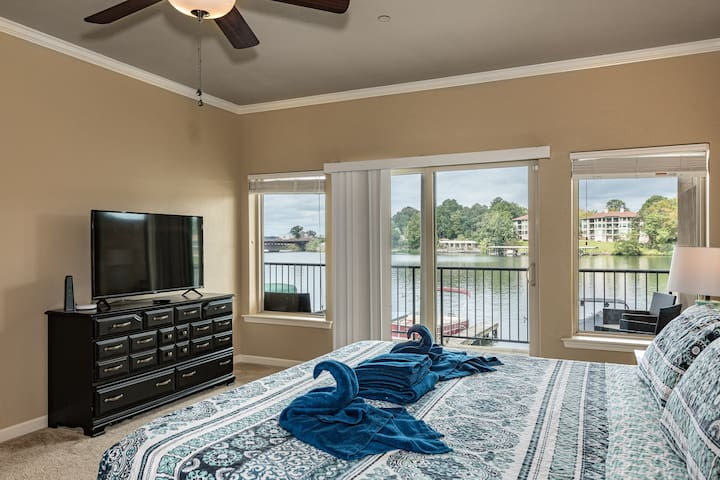 Master has beautiful view of he lake and sliding doors leading to the private balcony