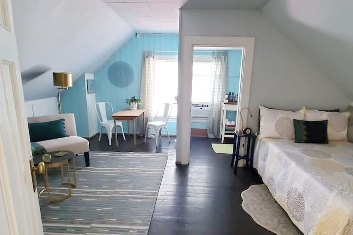 Your main room is spacious & airy. Ample space to relax or work (plus a light-duty kitchenette to yourself). Dining area. Closet space w/hangers. Memory foam mattress on the full-size bed. Large desk space (just to the left of this shot).
