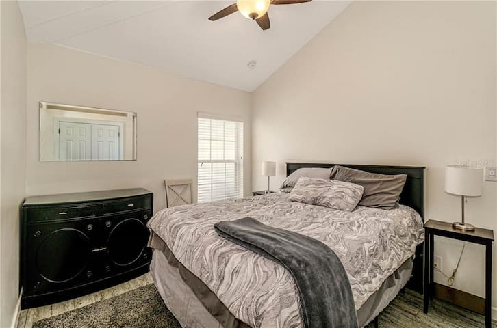 Bedroom with Queen sized bed, TV
