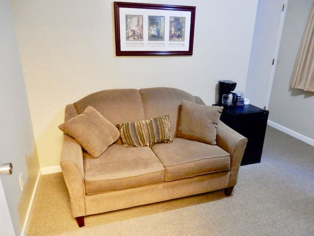 Comfy private seating area in your suite.