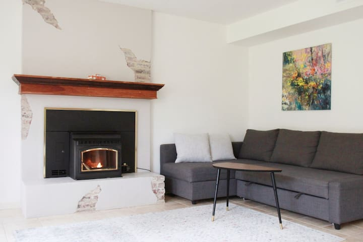 The apartment features a quiet pellet stove which can be easily turned on.
