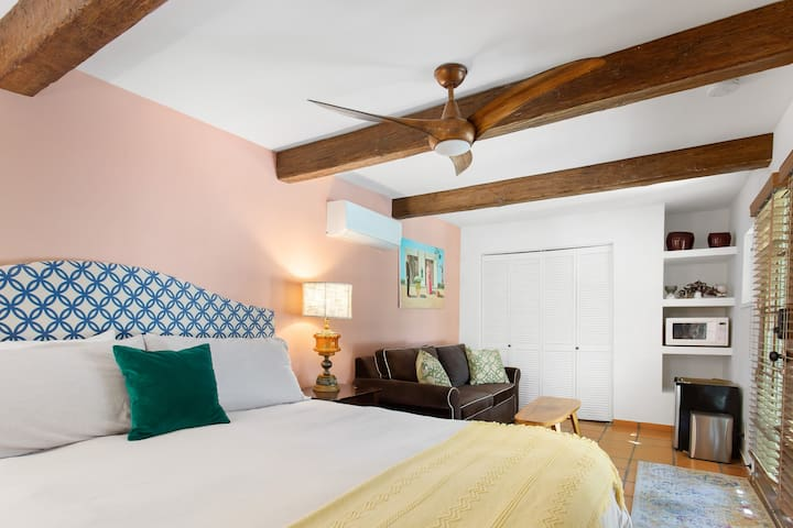 Bedroom #2; King Size bed in a classic Hacienda Casita. Spacious with additional daybed and small refrigerator.