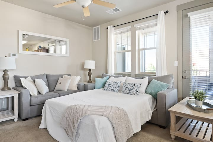 Airy living room with comfy Queen sized sleeper sofa, accommodations or up to 8 guests, and 50inch HD TV with YouTube tv and Hulu