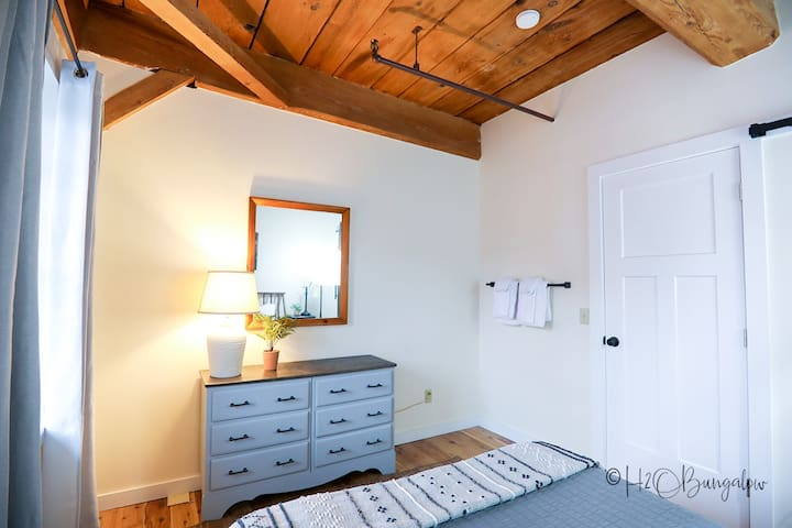Master bedroom has plenty of drawer space for guests.