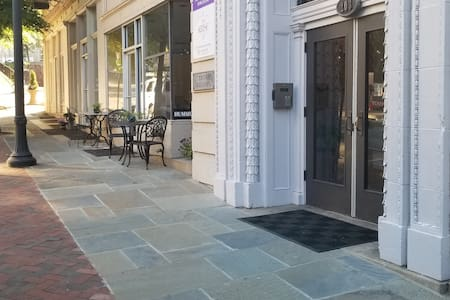 Excessively wide and well-manicured sidewalks lead up to the Krise building's front entrance.