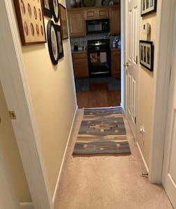 Hallway to room and kitchen