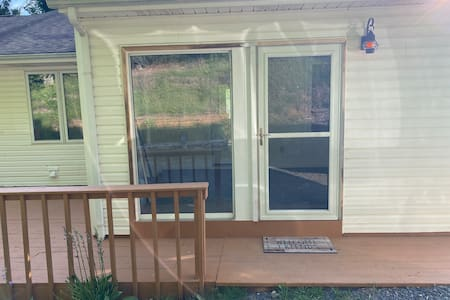 There is external lighting at the enclosed porch entrance and if you expect to arrive after dark, let us know and we will turn the light on as well as the lighting inside the enclosed porch. The driveway for parking is right beside this entrance