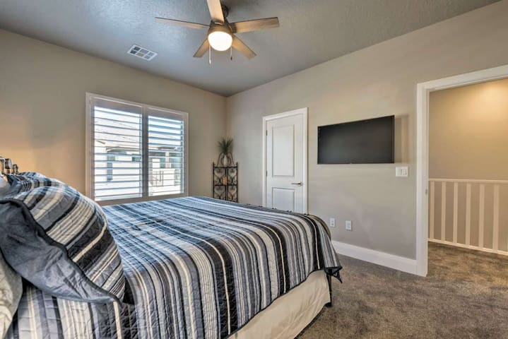 Bedroom 3, second floor, king bed, large TV, with private sink and access to Jack and Jill bathroom.