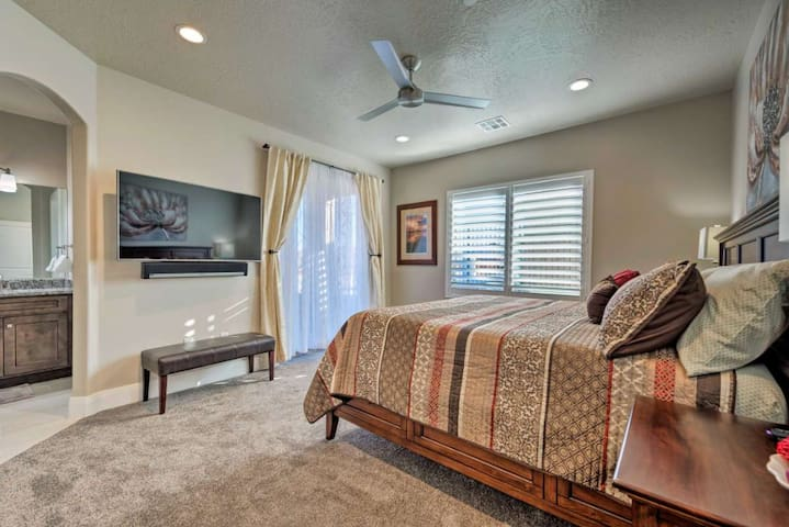 Main floor master bedroom with king size bed and private ensuite with walk-in shower. Large TV and Sonos sound system for entertainment.