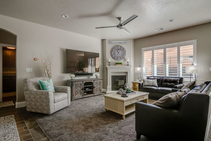 Tastefully decorated family room invites you to gather for visiting or enjoy a movie.