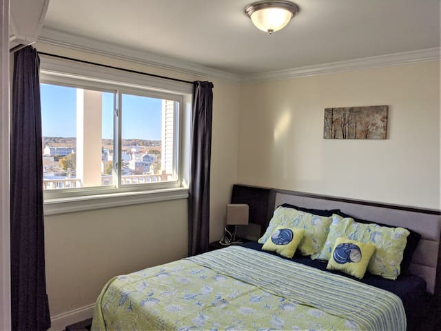 Quiet and spacious, comfortable  bedroom with queen memory foam mattress and pillow, light blocking curtains