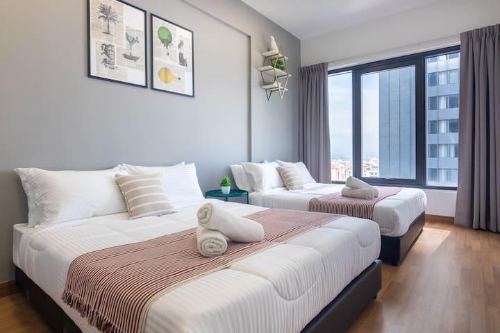 Bedroom 1 with 2 queen sized beds and en suite toilet.
