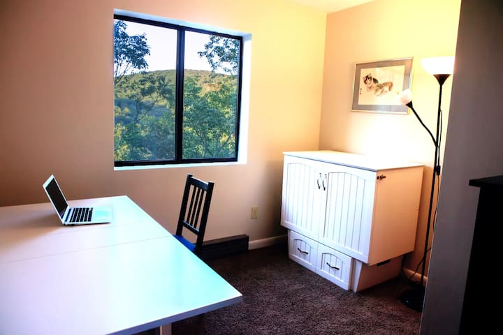 A great place to get a little work done... The small bedroom made up as a study. (Laptop not included.)