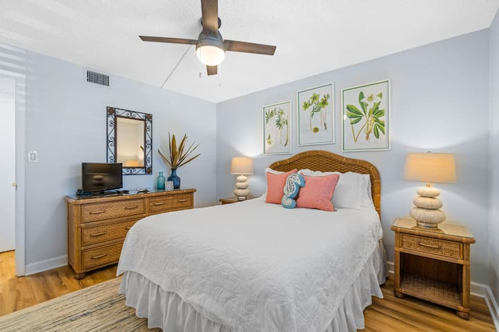 The bedroom features a comfortable queen bed