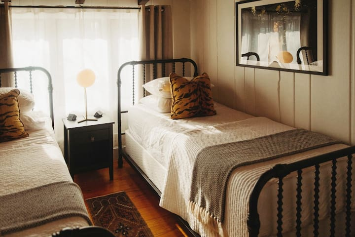 Second bedroom with Nectar mattresses, quality pillows and linens and light dimming curtains.   Photo by Rainstorm Photo