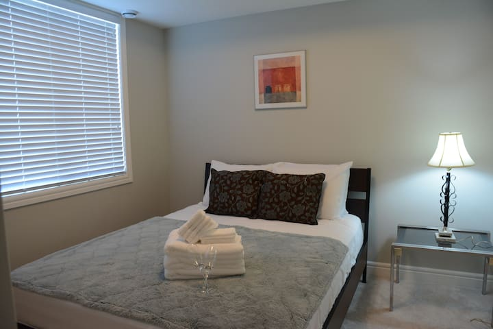 First bedroom with queen bed and big window