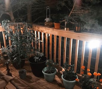 The string lights follow up the second flight of stairs, and wrap around the front deck so that it's visible from the parking area.