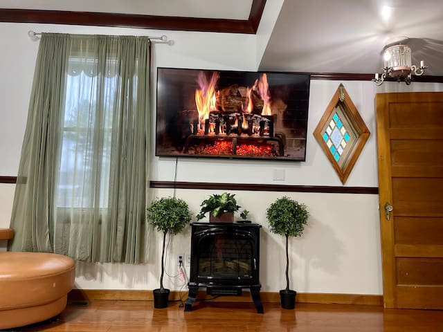 Living room equipped with a smart tv & electric fireplace (adjacent to the first bathroom).