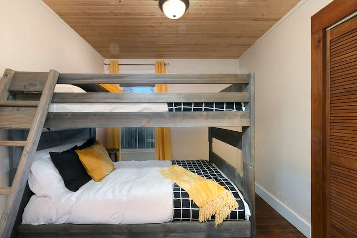 Yellow & Black bedroom with Full-size Bunkbeds