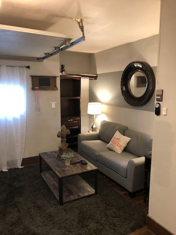 Quaint living area with television, kitchenette, and dinette.