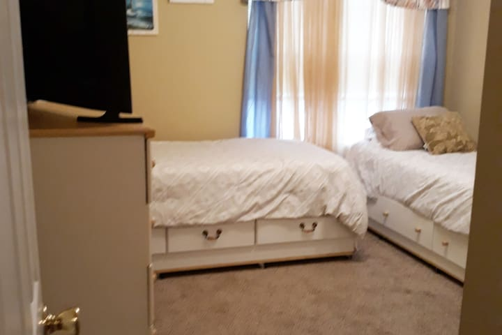 guest room.  View from door.  Beds and dressers get moved around periodically.  May or may not be in the same set up.