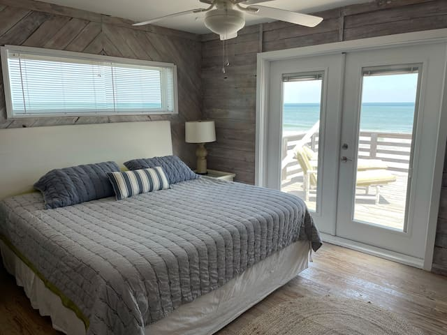 Wake up refreshed with a beautiful sunrise ocean view from the king size bed.