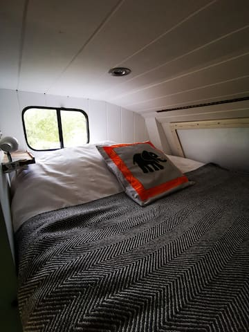 Double bed above cab, looking out over veggie garden