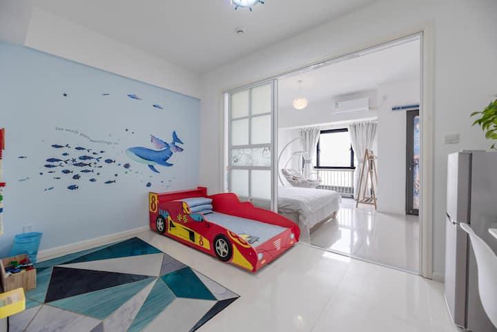 舒适双床亲子房+高清投影+乐高绘画墙+近大学、海昌海洋公园