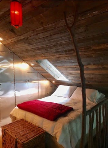 Sleeping on the split level loft. Queen bed plus two singles in shared space.