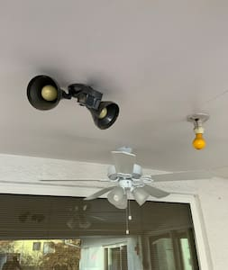 We have a motion activated light as well as overhead lighting that operates by a pull tab off of the fan.