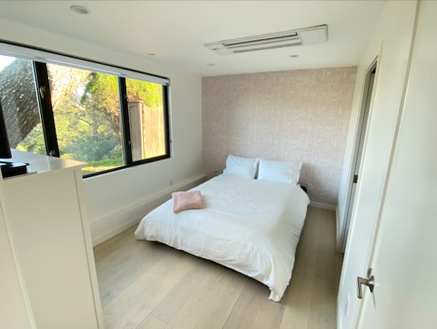 Peaceful bedroom with fantastic view into valley below. Queen-sized bed with brand new Casper mattress. Flat screen television in bedroom for watching movies at night.