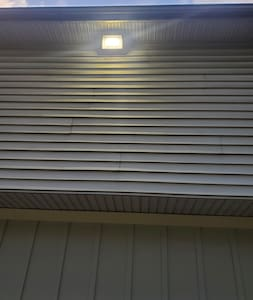 Flood lights on house to light the walkway and driveway