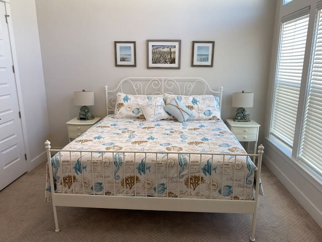 Master Bedroom with king-size bed and smart TV