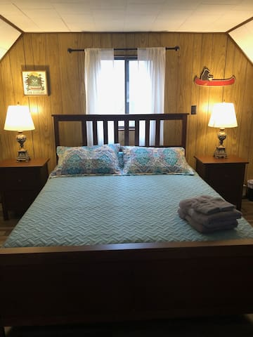 Loft Area- Queen Bed.   Sheets, pillows, blankets, towels, & washcloths are provided for each guest.   Oscillating pedestal fan is provided for warmer months.