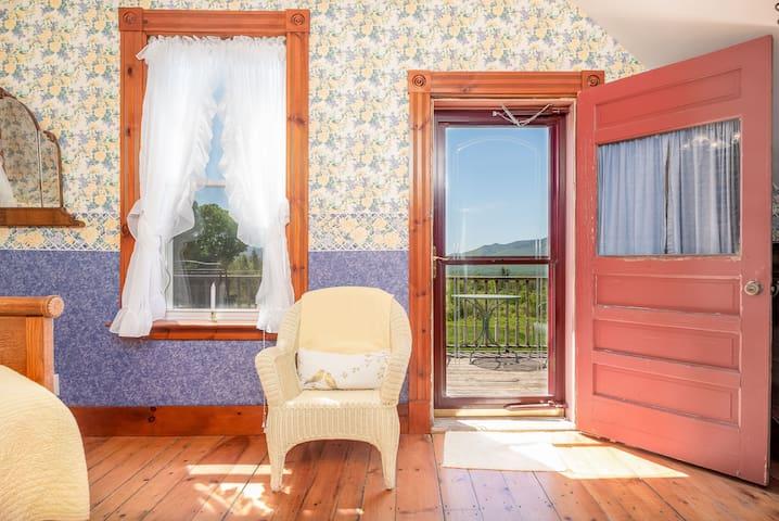 Bedroom #7 has a balcony overlooking the mountain range