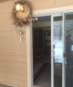 The bright outdoor light is beside the main sliding door entrance.