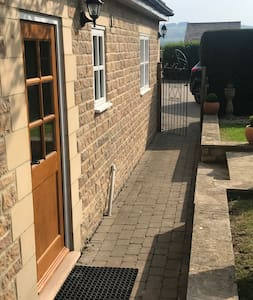 Lit block paving path from parking driveway to front door. No steps.