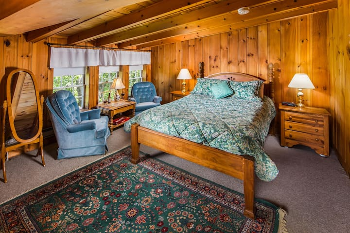 """An old post and beam barn has been remodeled into guests rooms in our Carriage House.  These unique rustic rooms are perfect for your """"Swiss Chalet"""" experience with our classic New England charm."""