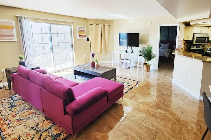 Living room fully Sanitized and cleaned, very spacious, can be used as a sleeping area, comes with airbed, couch or futon,tv,wifi and access to a balcony, washer/Dryer. Spacious, Entire Place, Airbnb is 2 Bedroom, 2 Bath in Las Vegas, NV by the strip