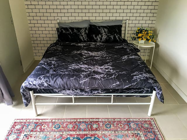 Comfy Queen bed waiting for you!