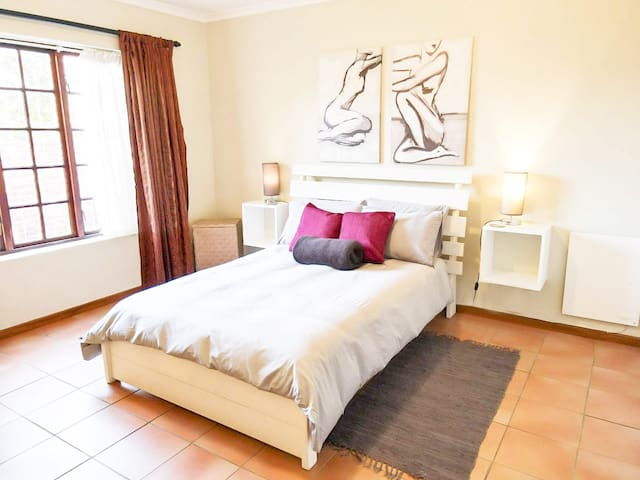 Spacious main bedroom with lovely afternoon sun for those lazy holiday siestas!