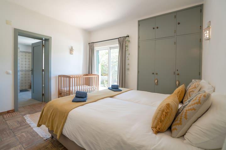 Bedroom 2: Bedroom with ensuite bathroom, large wardrobe and cot