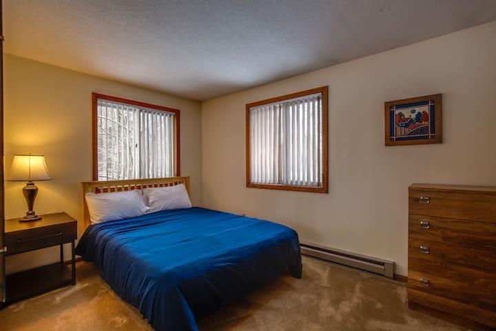 Queen bedroom with brand new bedframe and mattress.