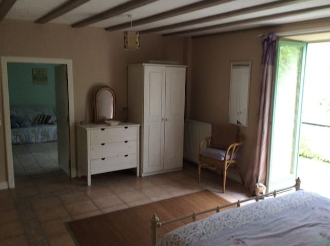 Master bedroom with doorway to Garden Room and French Windows to the Terrace
