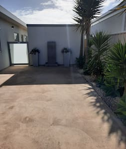 Car space for guests, displaying lovely wide area for access to home.