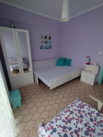 the second bedroom with three single beds or a double and a single bed