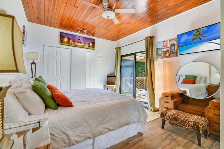 Master bedroom opens to a private outdoor deck.